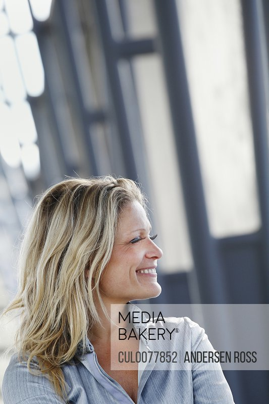 Smiling businesswoman standing outdoors