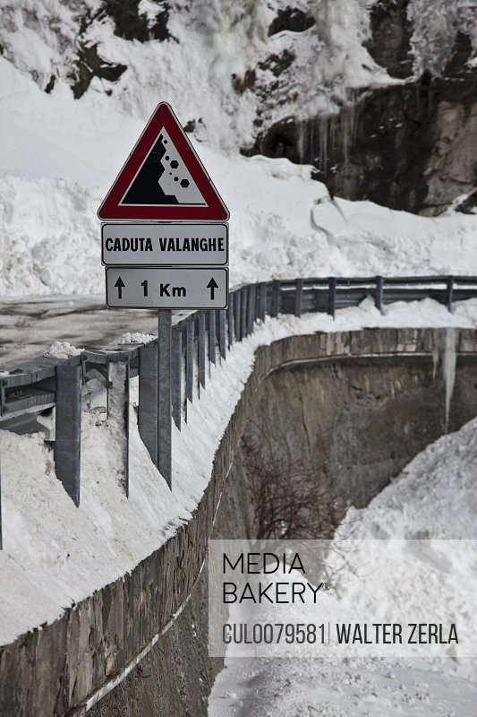 Falling rocks sign in snowy landscape