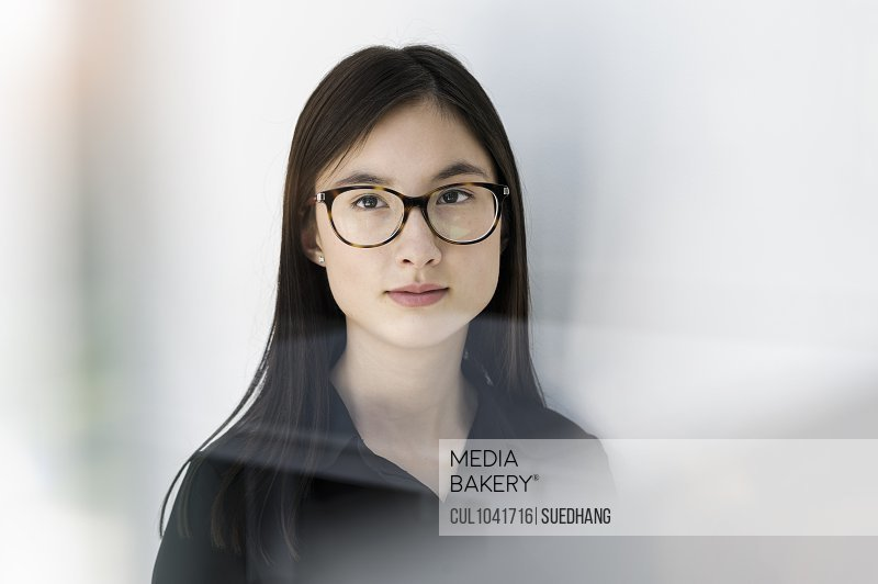 Young woman with round eye glasses