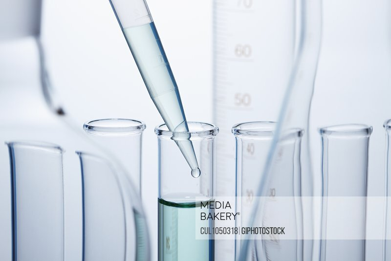 A precision micropipette is used to transfer a small amount of liquid to a test tube. Pipettes are commonly used in chemical and biological laboratory research