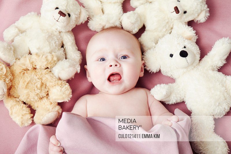 Mediabakery Photo By Cultura Images Baby Girl Lying Surrounded