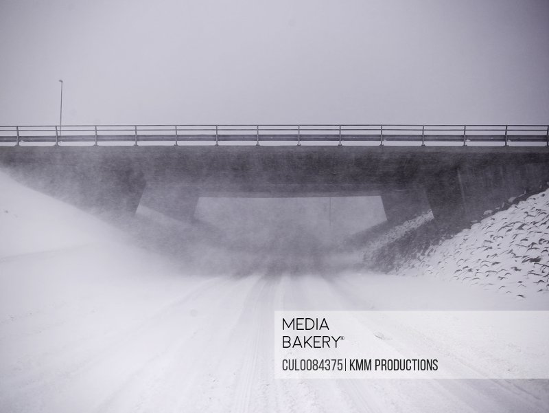 Snowy overpass in rural landscape
