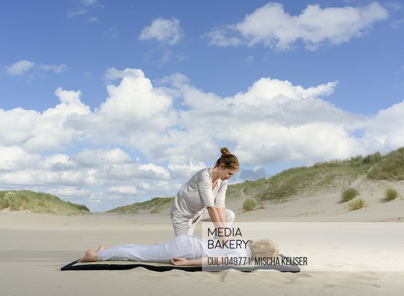 A professional masseuse at work on sand dunes, Oostkapelle, Zeeland, the Netherlands