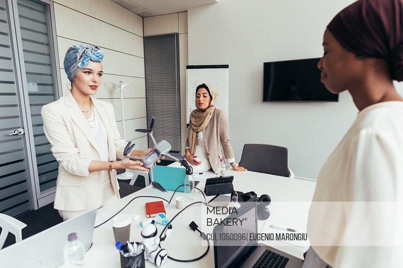 Businesswomen discussing drone