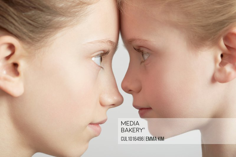 Portrait of two girls, face to face, close-up