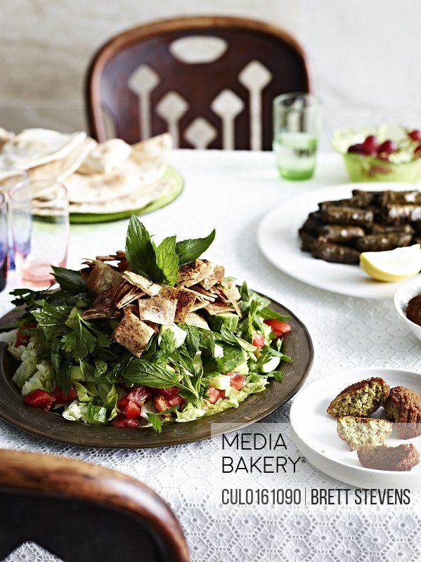 Still life with fattoush vine leaves and flat breads