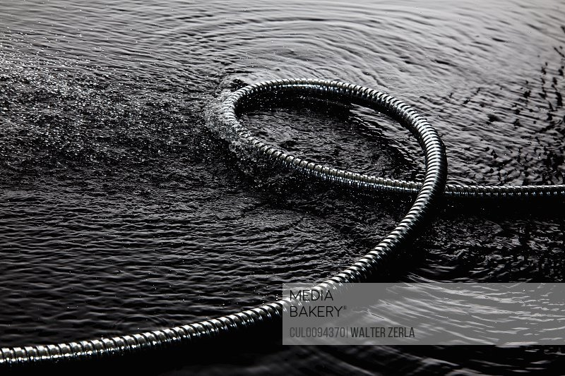 Coiled metal tube in water