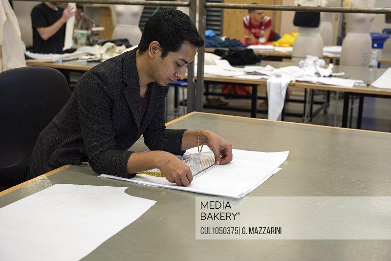 Fashion student working on design
