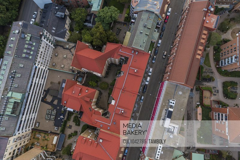 Birds eye view of a Malmo street and buildings with red roofs.