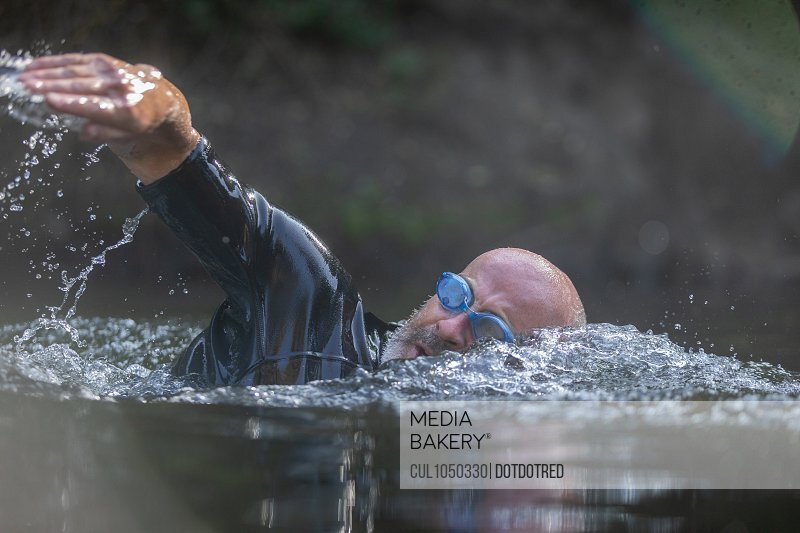 Man swimming in river