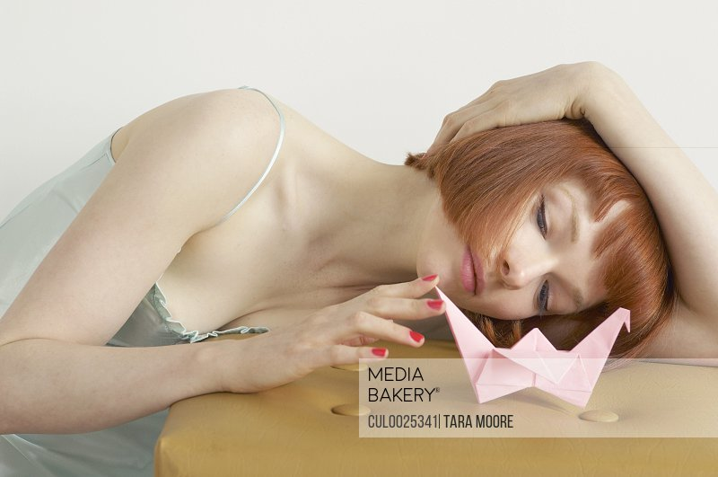 woman playing with origami swan