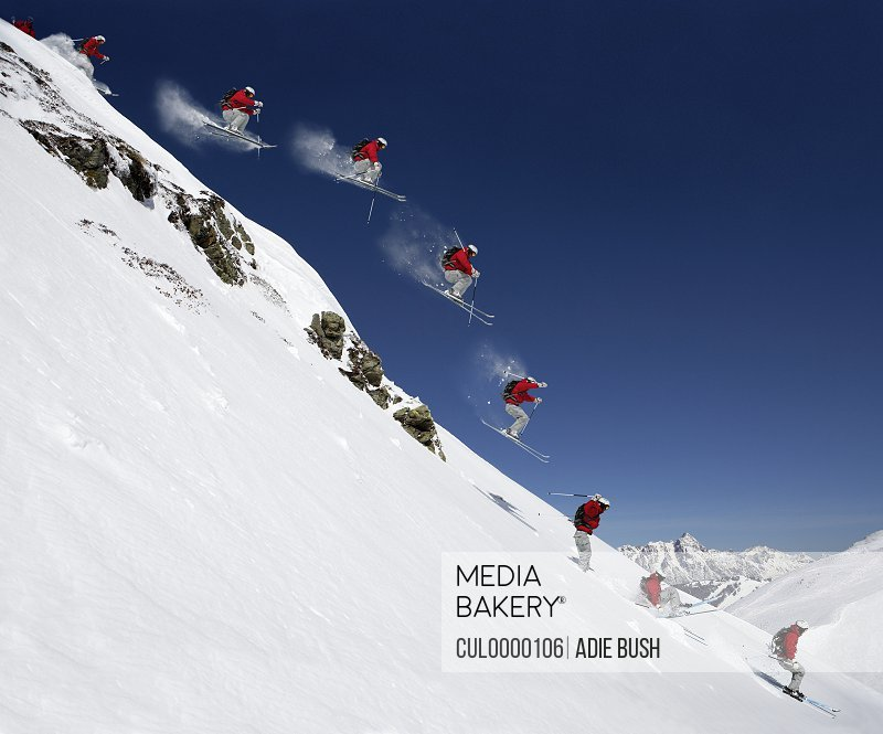 Sequence of male skier jumping down steep slope (Digital Composite)