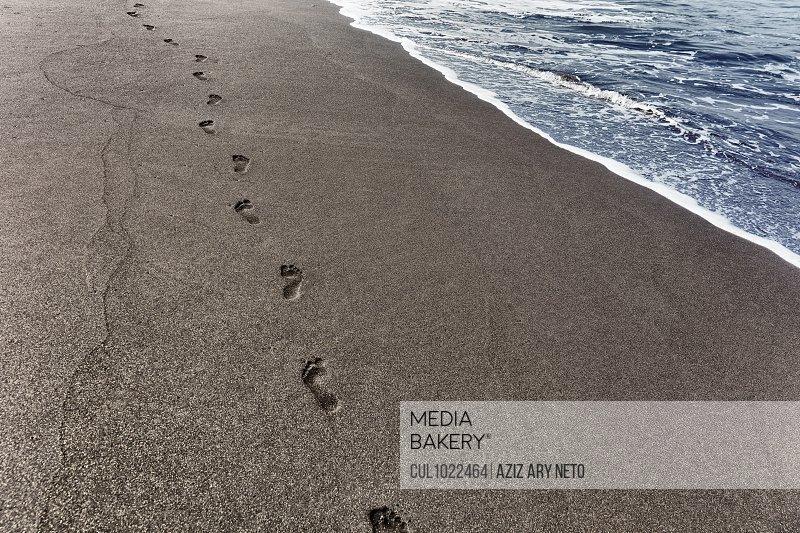 Footprints in sand on coastline, Sao Filipe, Fogo, Cape Verde, Africa