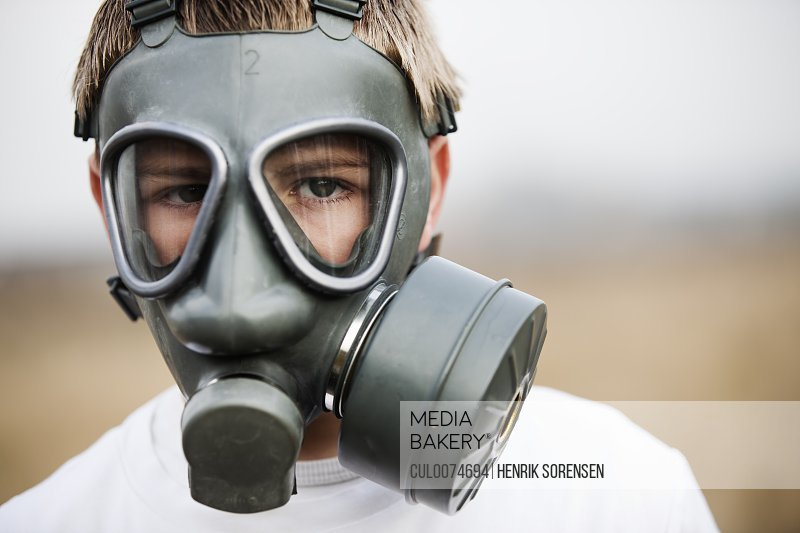 Close up of boy wearing gas mask