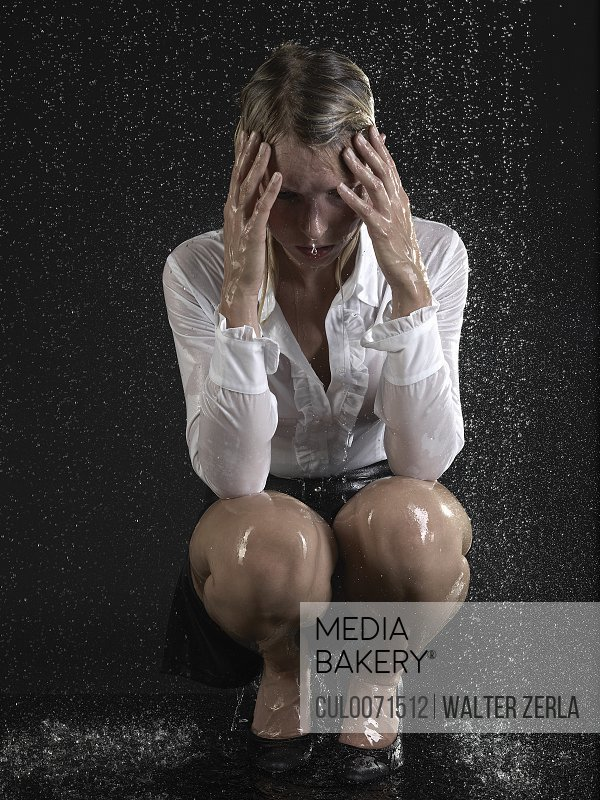 Frustrated business woman in rain