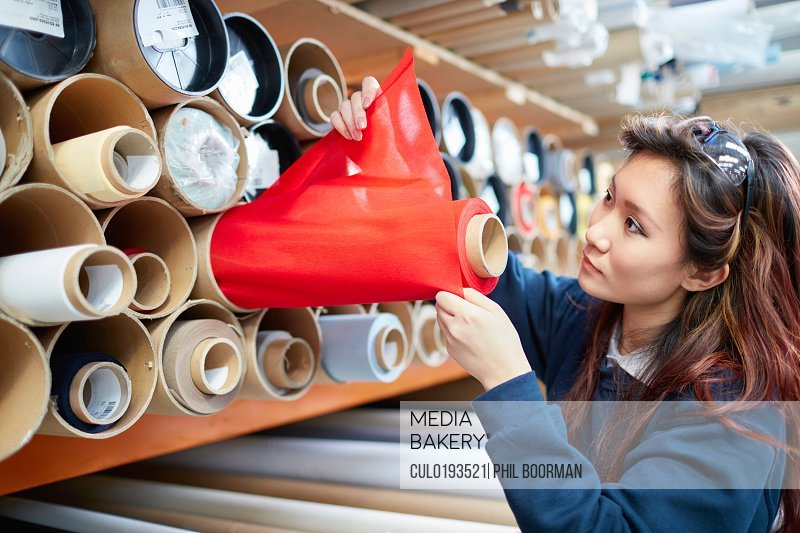 d7d83008d1 Mediabakery - Photo by Cultura Images - Female worker examining red ...