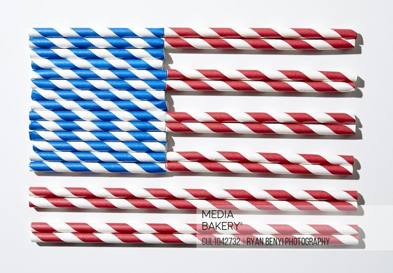 Coloured straws in red and white and blue and white laid out to look like the American flag.