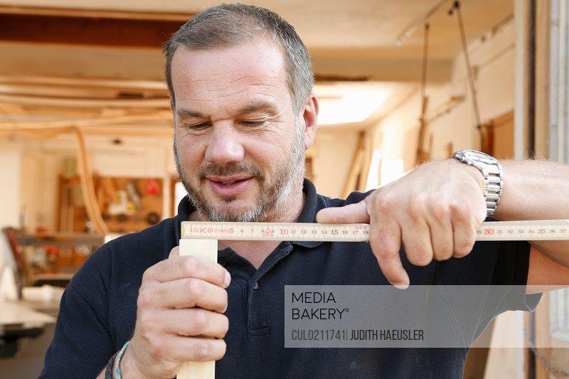 Man measuring timber