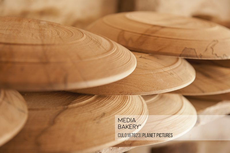 Hand turned wooden plates close-up