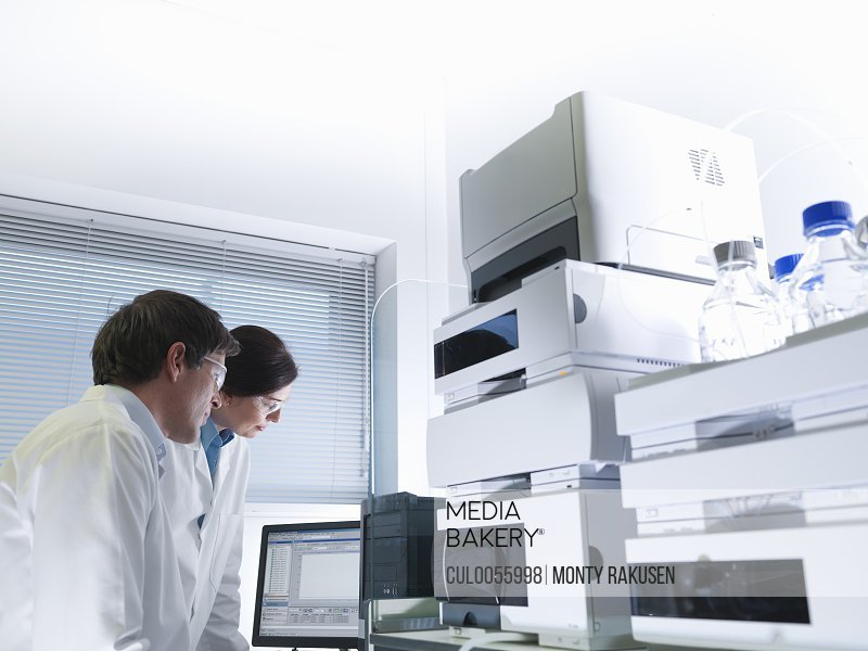 Scientists with electronic test machine