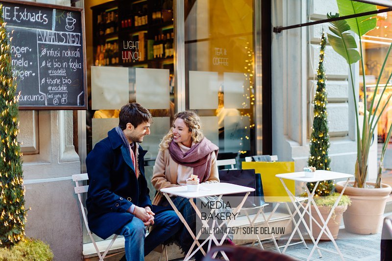 Couple talking at cafe, Firenze, Toscana, Italy