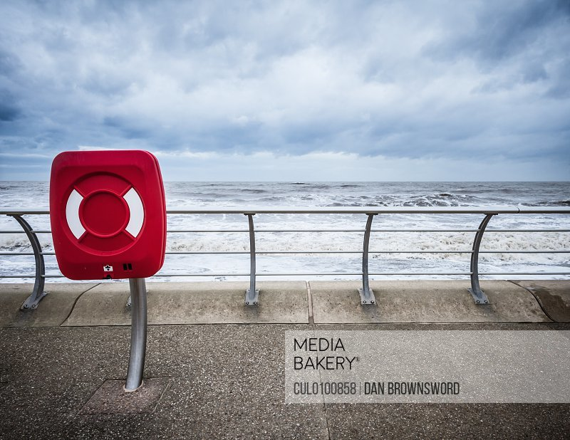Red sign at beach wall