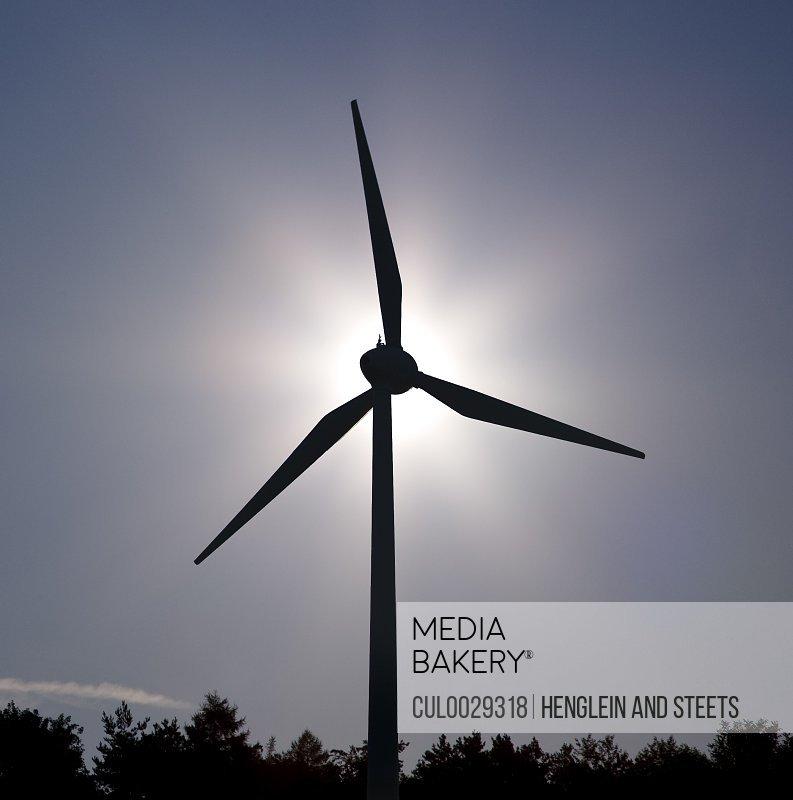 sun behind Wind Turbine