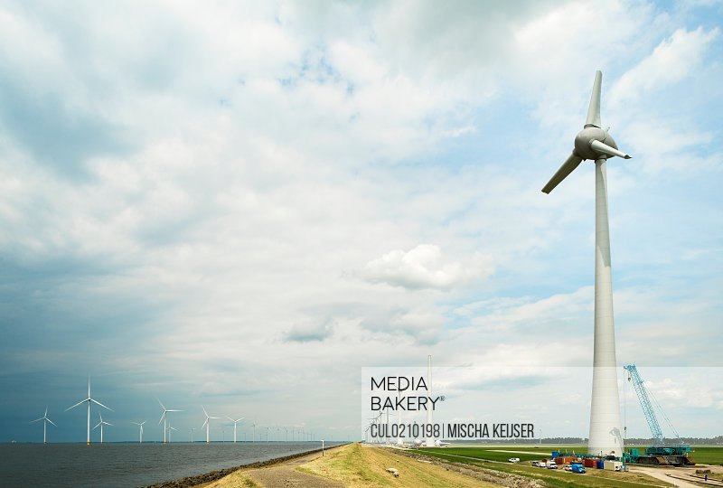 Windfarm offshore and on land, IJsselmeer lake, Espel, Flevopolder, Netherlands