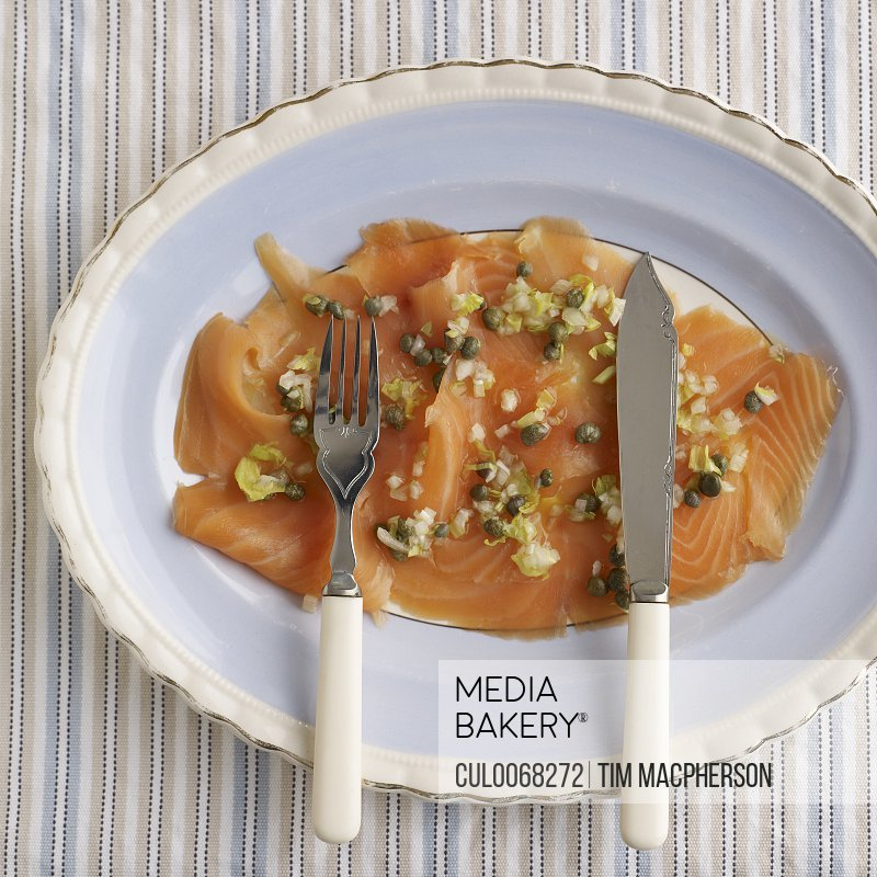 Plate of smoked salmon with capers