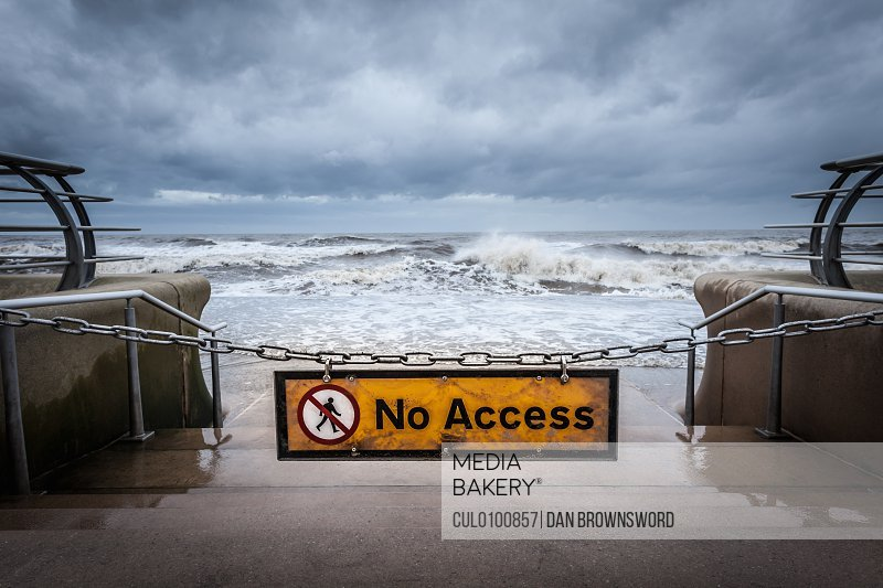 No access sign at stormy beach