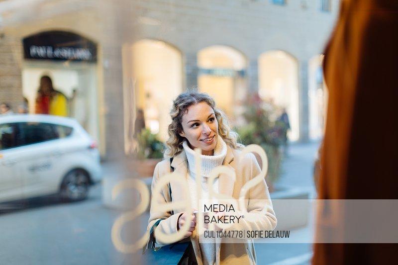 Woman window shopping, Firenze, Toscana, Italy