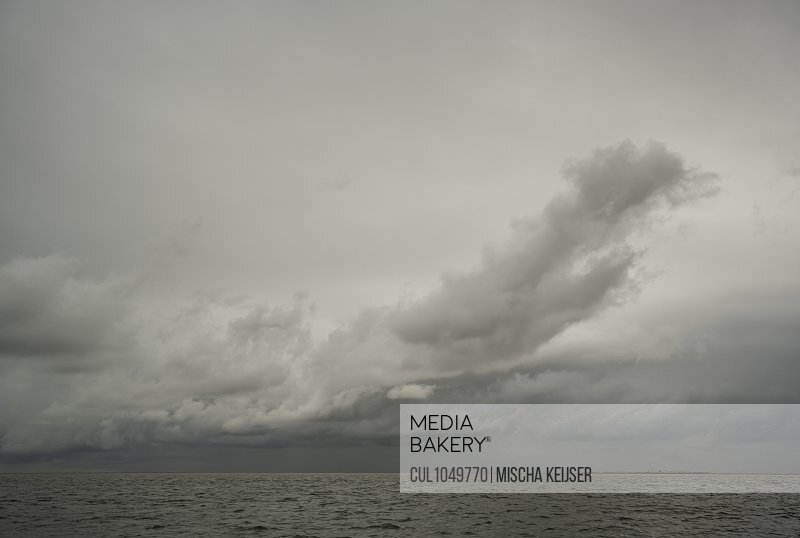 Dark cloud forming over the Wadden sea, West-Terschelling, Friesland, The Netherlands