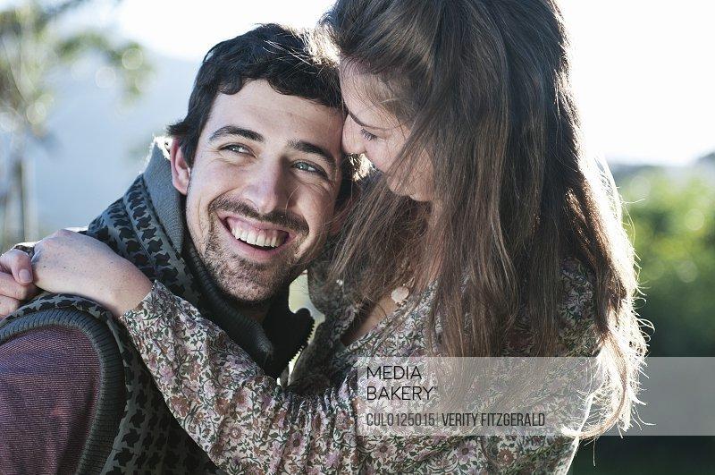 Young woman hugging boyfriend