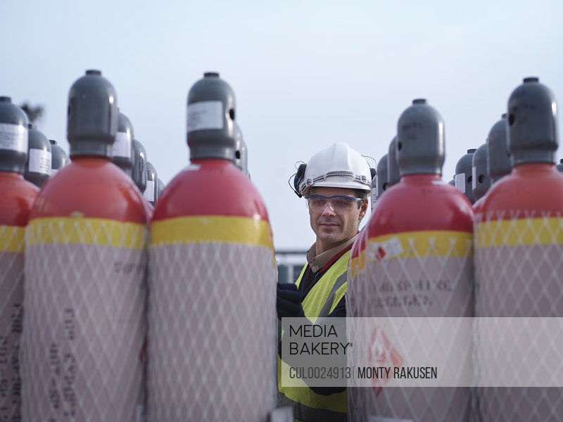 Port Worker Inspecting Gas Canisters