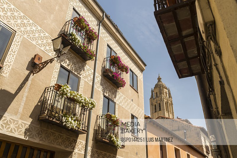 Residential buildings in downtown Segovia with the tower of the Cathedral as background; Segovia, Castilla Leon, Spain