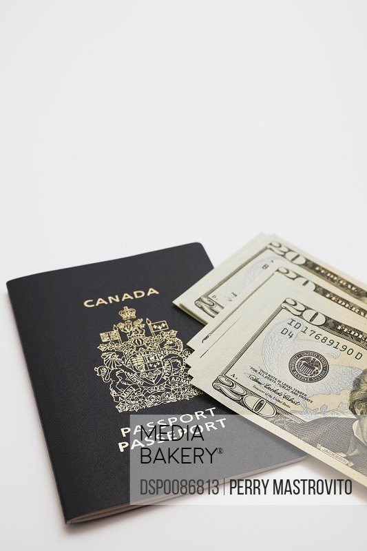 Canadian Passport And Us Twenty Dollar Bills