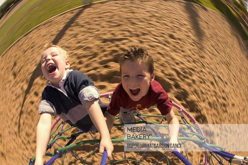 Two boys playing at the adventure park