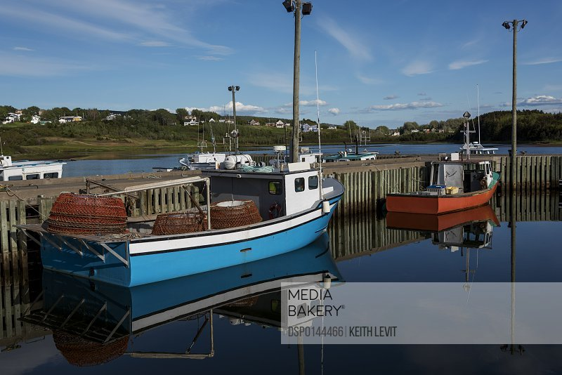 Fishing boats in the tranquil harbour; Mabou, Nova Scotia, Canada