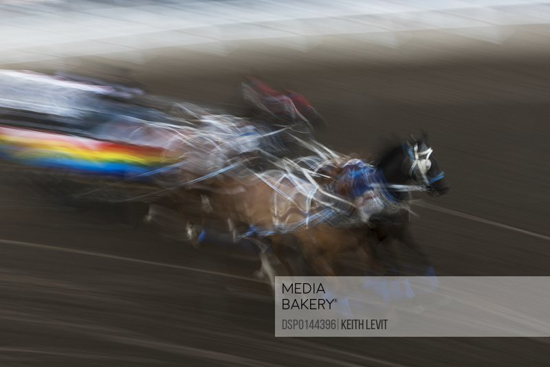 Blur of colour and motion of a chuckwagon race, Lakeview Calgary Stampede Event; Calgary, Alberta, Canada