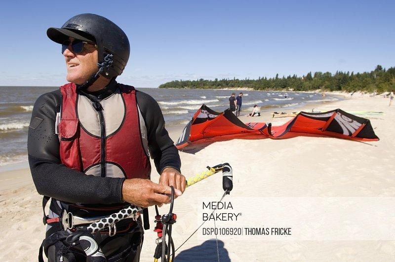 Photo by Design Pics - Man Kite Boarding, Victoria Beach, Manitoba