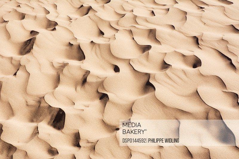 Close up of sand dune pattern looks like waves of sand; Mendoza, Argentina