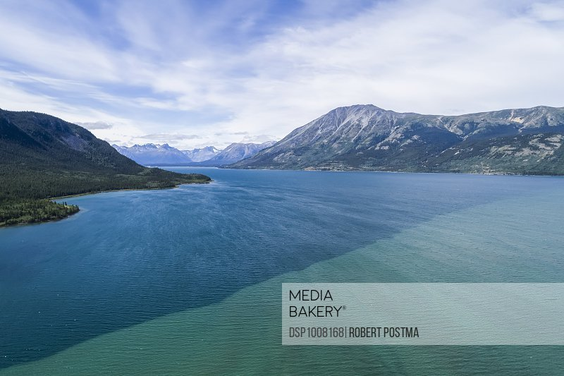 The colour difference of Bennett Lake which the town of Carcross sits along; Carcross, Yukon Territory, Canada