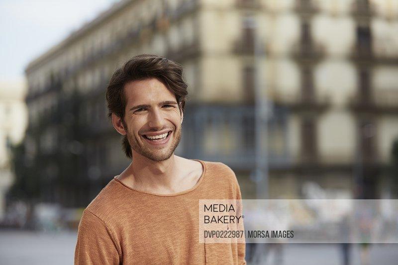 Man smiling in city