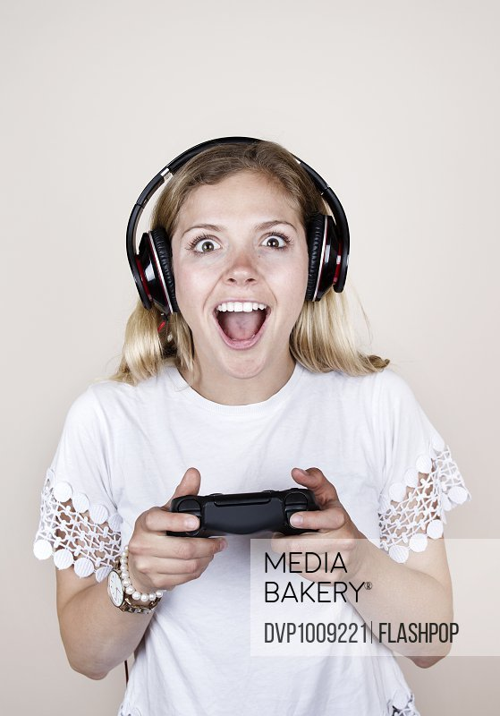 Woman playing with games console