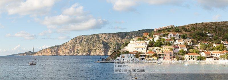Town and harbour of Assos at sunset. Greece