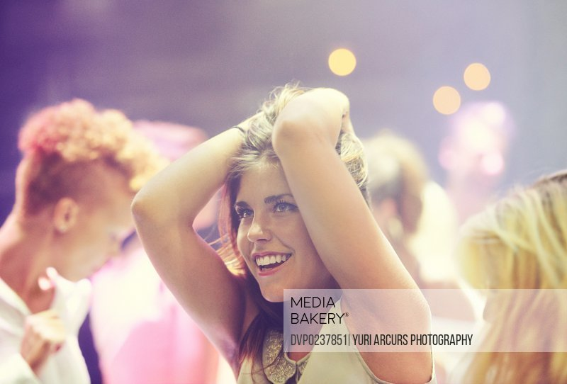A young girl partying in a club and moving to the music. This concert was created for the sole purpose of this photo shoot, featuring 300 models and 3 live bands. All people in this shoot are model released.