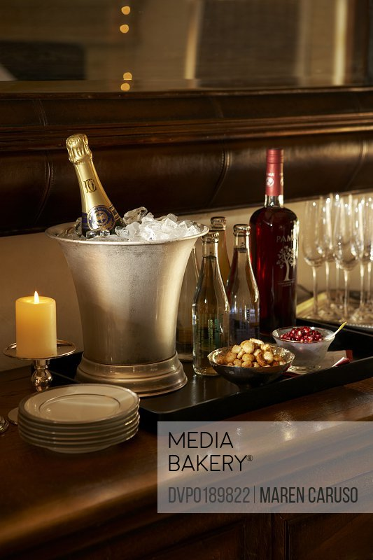 Champagne bottles in ice buckets with glasses on table