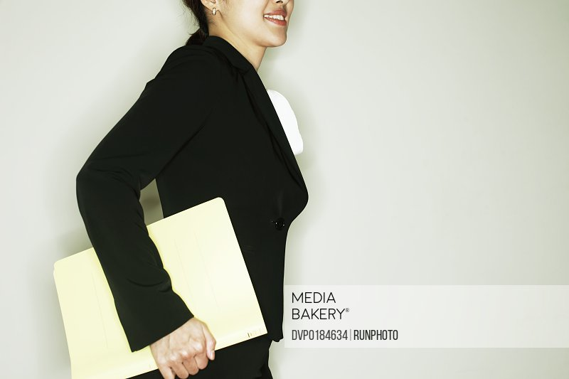 midle age businesswoman with a binder