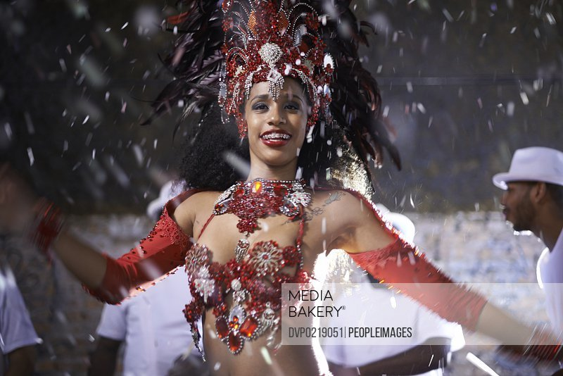 Cropped shot of a beautiful samba dancer performing in a carnival with her band