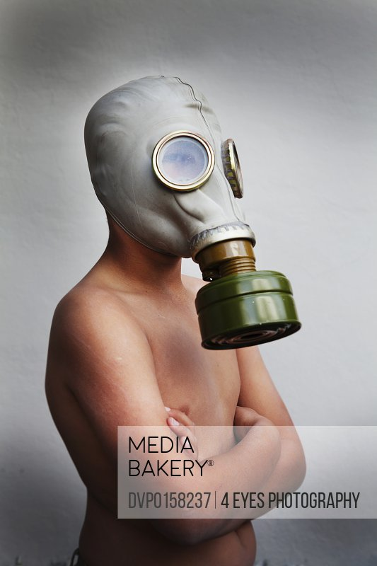 Young boy wearing a gas mask